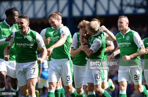 Vykintas Slivka of Hibernian celebrates scoring with his team mates during the Ladbrokes Scottish Premiership match between Rangers and Hibernian at...
