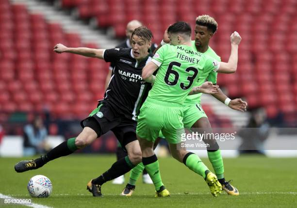 Vykintas Slivka of Hibs tackles Kieran Tierney of Celtic during the Betfred Cup SemiFinal between Hibernian and Celtic at Hampden Park on October 21...