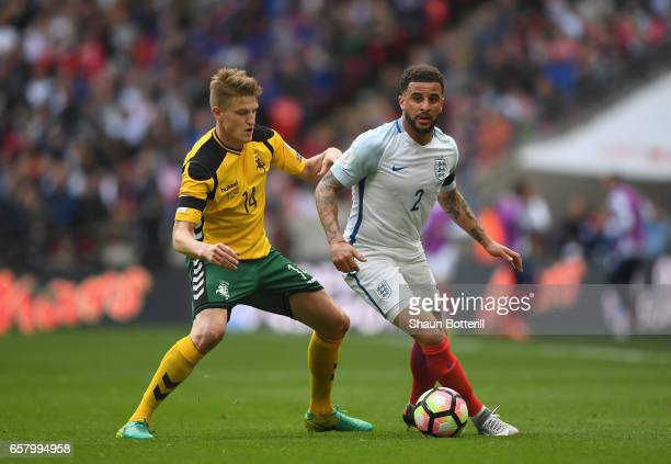 Vykintas Slivka of Lithuania and Kyle Walker of England during the FIFA 2018 World Cup Qualifier between England and Lithuania at Wembley Stadium on...