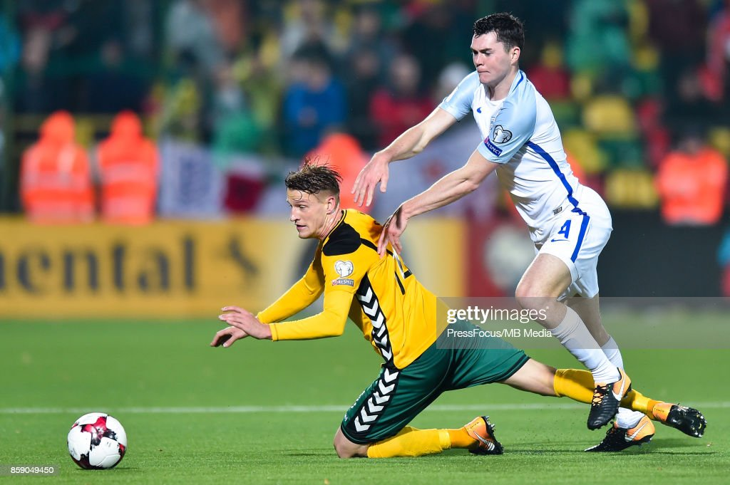 Vykintas Slivka of Lithuania and Michael Keane of England during the FIFA 2018 World Cup Qualifier between Lithuania and England on October 8, 2017 in Vilnius, Lithuania.