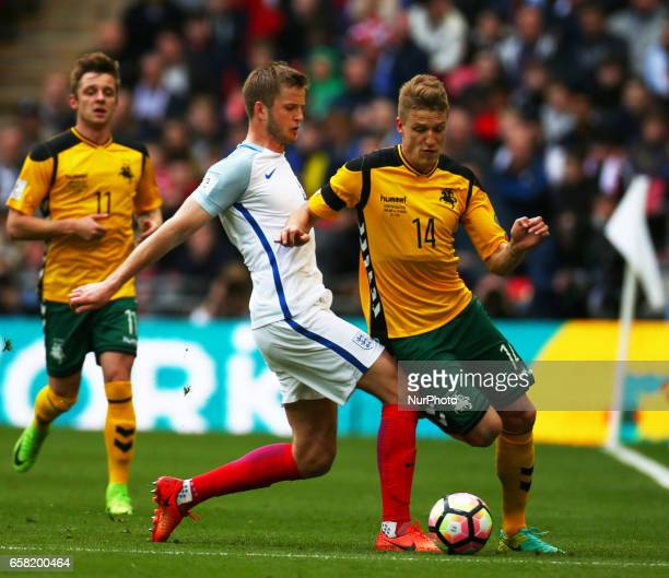 Vykintas Slivka of Lithuania gets tackled by England's Eric Dier during FIFA World Cup Qualfying European Group F match between England against...