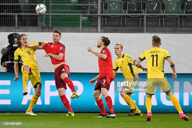Vykintas Slivka of Lithuania is challenged by Nico Elvedi of Switzerland during the FIFA World Cup 2022 Qatar qualifying match between Switzerland...