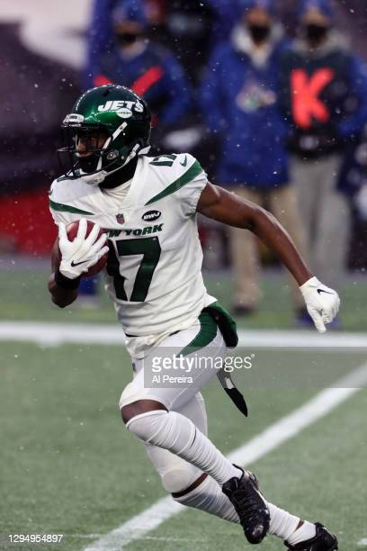 Vyncint Smith of the New York Jets has a long return against the New England Patriots at Gillette Stadium on January 3, 2021 in Foxborough,...