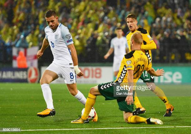Vytautas Andriuskevicius of Lithuania tackles Jordan Henderson of England during the FIFA 2018 World Cup Group F Qualifier between Lithuania and...