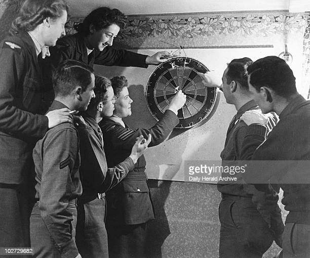 WAAFs and US pilots playing darts 15 Decem WAAFs and US pilots playing darts 15 December 1942 'WAAFs help United States Fighter Command At the...
