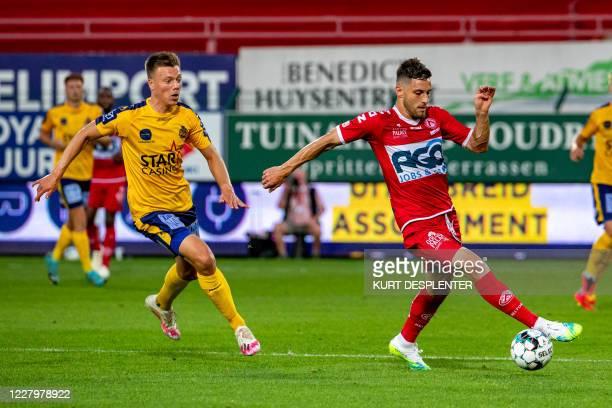 Waasland-Beveren's Daan Heymans and Kortrijk's Petar Golubovic fight for the ball during the Jupiler Pro League match between KV Kortrijk and...