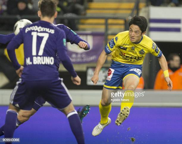 WaaslandBeveren's Ryota Morioka kicks the ball past Anderlecht's Massimo Bruno in a 22 draw in the Belgian first division A in Brussels on Jan 24...