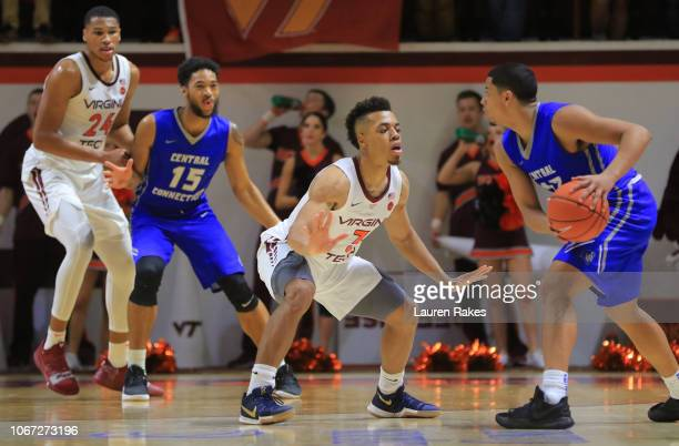 Wabissa Bede of the Virginia Tech Hokies looks to defend against Tyson Batiste of the Central Connecticut State Blue Devils during the game at...