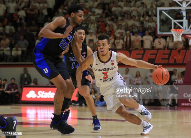 Wabissa Bede of the Virginia Tech Hokies runs past Jordan Goldwire and Marques Bolden of the Duke Blue Devils at Cassell Coliseum on February 26 2019...