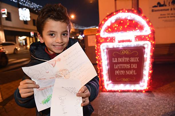 Wacil a five year old french child shows his letter for santa claus wacil a five year old french child shows his letter for santa claus spiritdancerdesigns Images