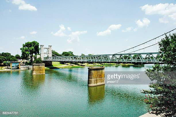 waco suspension bridge crossing the brazos river - waco stock pictures, royalty-free photos & images