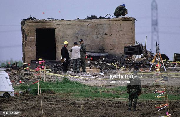 Waco, Texas: FBI And ATF Agents Sifting Through Rubble Following The Branch Davidian Fire. Red Flags Correspond To Bodies Found.