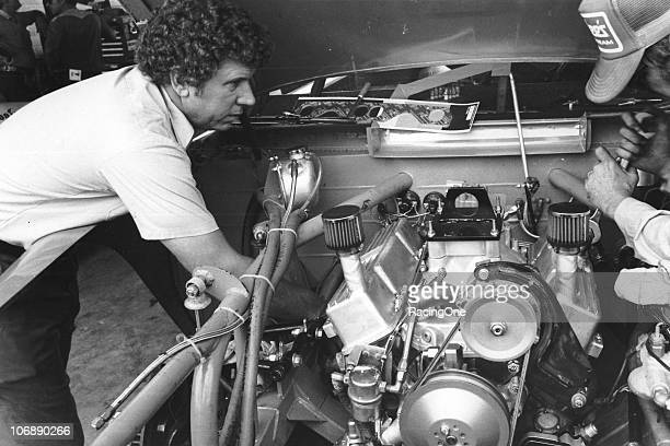 Waddell Wilson checks over the engine of Cale YarboroughÕs NASCAR Cup car in the garage area before a Cup race A Wilsonbuilt engine was the first to...