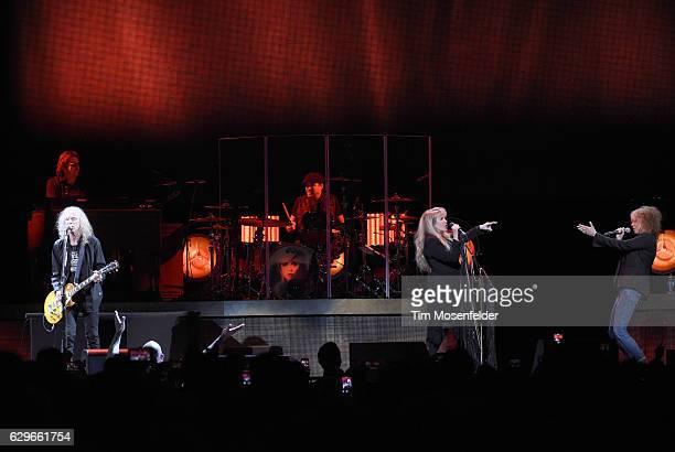 Waddy Wachtel Stevie Nicks and Chrissie Hynde perform during Stevie's '24 Karat Gold Tour' at Golden 1 Center on December 13 2016 in Sacramento...
