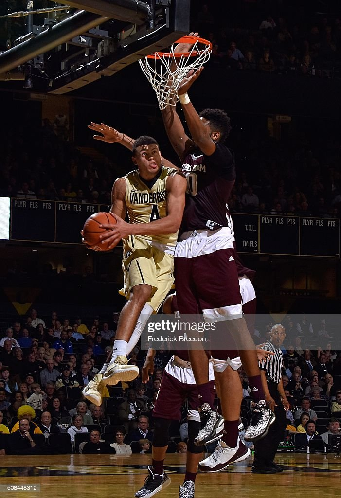 Wade Baldwin IV #4 of the Vanderbilt Commodores jumps up for a shot against Tonny Trocha-Morelos #10 of the Texas A&M Aggies during the second half of a 77-60 Vanderbilt upset of Texas A&M at Memorial Gym on February 4, 2016 in Nashville, Tennessee.