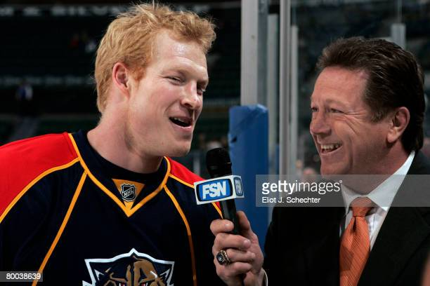 Wade Belak of the Florida Panthers is interviewed by Denis Potvin prior to the start of the game against the Toronto Maple Leafs at the Bank Atlantic...