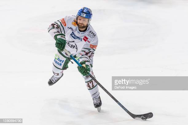 Wade Bergmann of Augsburger Panther controls the puck during the DEL match between EHC Red Bull Muenchen and Augsburger Panther on January 12, 2021...