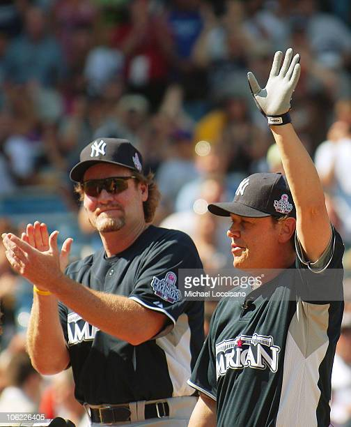 Wade Boggs and Billy Crystal wave to the crowd during the 2008 MLB AllStar Week Taco Bell AllStar Legends Celebrity Softball Game at Yankee Stadium...