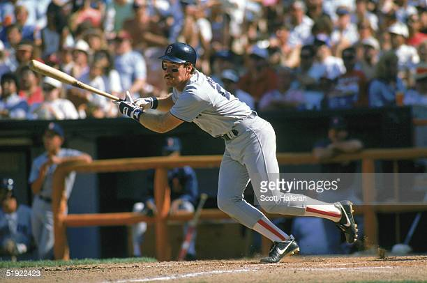 Wade Boggs of the Boston Red Sox follows through on his swing during a game against the California Angels in 1989 at Anaheim Stadium in Anaheim...