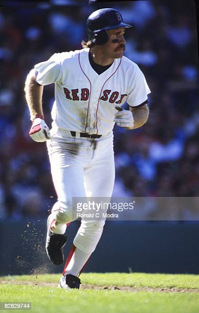 Wade Boggs of the Boston Red Sox runs to first base during a MLB game against the New York Yankees in Fenway Park on September 9 1984 in Boston...