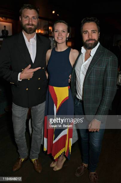 Wade Crescent, Charlotte Carroll and Diego Bivero-Volpe attend Charlotte Carroll's surprise birthday party at Nolita Social on July 8, 2019 in...