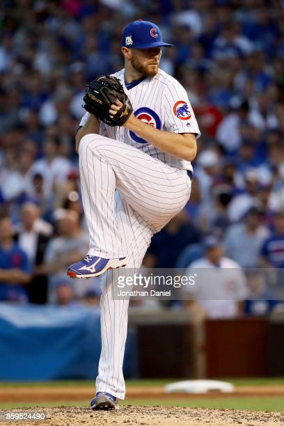 Wade Davis of the Chicago Cubs pitches in the ninth inning against the Washington Nationals during game three of the National League Division Series...