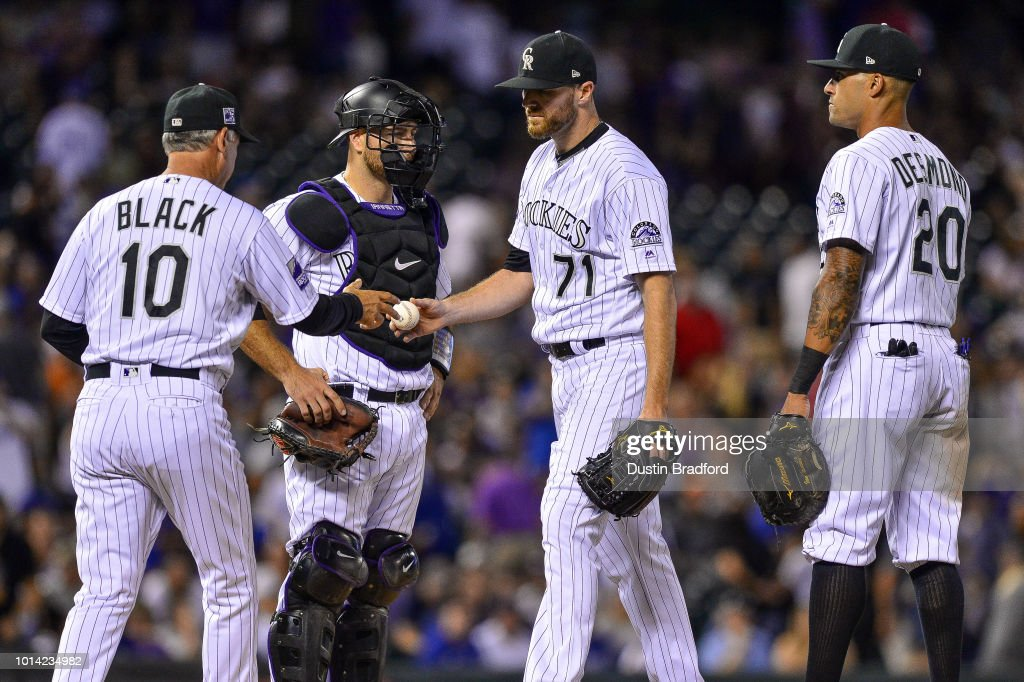 Wade Davis #71 of the Colorado Rockies is pulled from the game by manager Bud Black #10 after allowing three runs on two home runs in the top of the ninth inning of a game against the Los Angeles Dodgers at Coors Field on August 9, 2018 in Denver, Colorado.