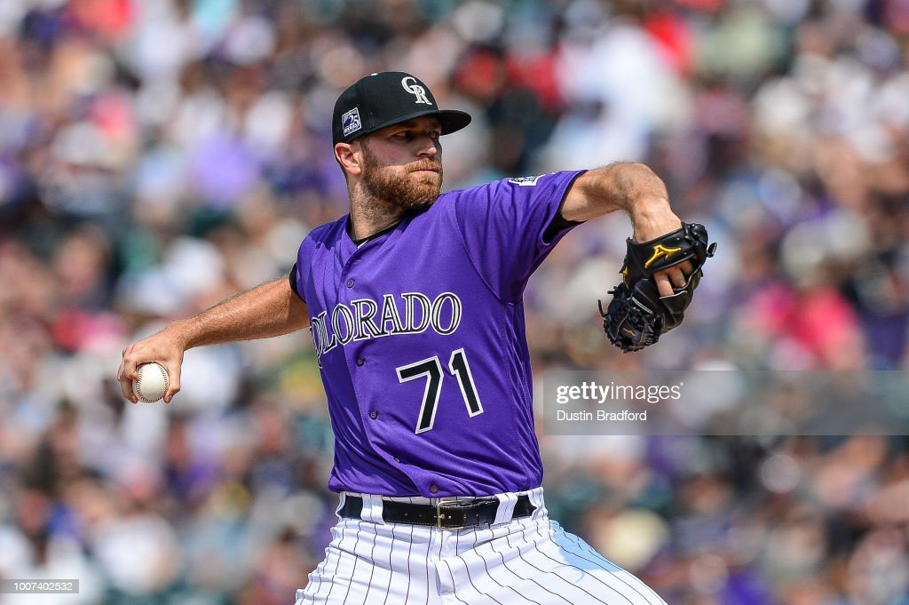 Wade Davis #71 of the Colorado Rockies pitches against the Oakland Athletics in the ninth inning of a game during interleague play at Coors Field on July 29, 2018 in Denver, Colorado.