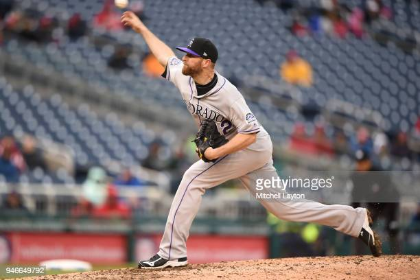 Wade Davis of the Colorado Rockies pitches in the ninth inning for his 7th save during a baseball game against the Washington Nationals at Nationals...