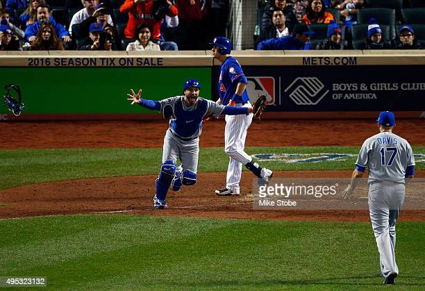 Wade Davis of the Kansas City Royals celebrates with Drew Butera of the Kansas City Royals after defeating the New York Mets to win Game Five of the...