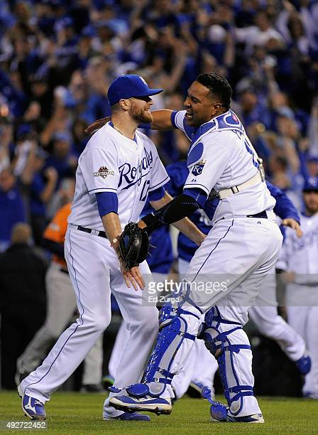 Wade Davis of the Kansas City Royals celebrates with Salvador Perez of the Kansas City Royals after defeating the Houston Astros 72 in game five of...