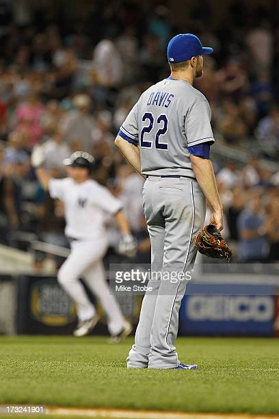 Wade Davis of the Kansas City Royals reacts after giving up a a sixth inning grandslam to Lyle Overbay of the New York Yankees at Yankee Stadium on...
