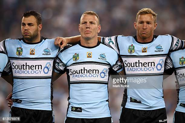 Wade Graham Luke Lewis and Matt Prior of the Sharks sing the national anthem before the 2016 NRL Grand Final match between the Cronulla Sharks and...