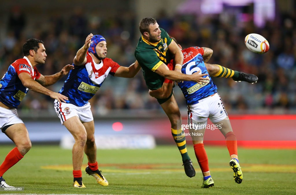 Wade Graham of Australia is up ended after offloading during the 2017 Rugby League World Cup match between Australian Kangaroos and France at Canberra Stadium on November 3, 2017 in Canberra, Australia.