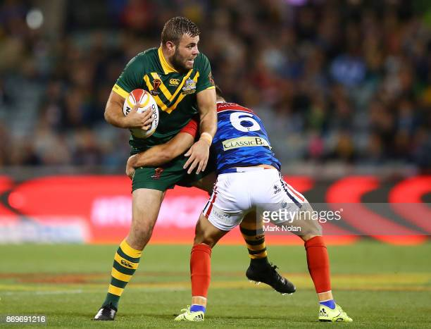 Wade Graham of Australia looks to offload as he is tackled during the 2017 Rugby League World Cup match between Australian Kangaroos and France at...