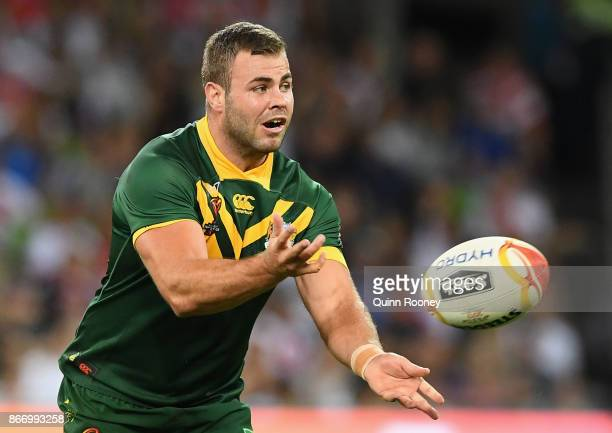 Wade Graham of Australia passes the ball during the 2017 Rugby League World Cup match between the Australian Kangaroos and England at AAMI Park on...