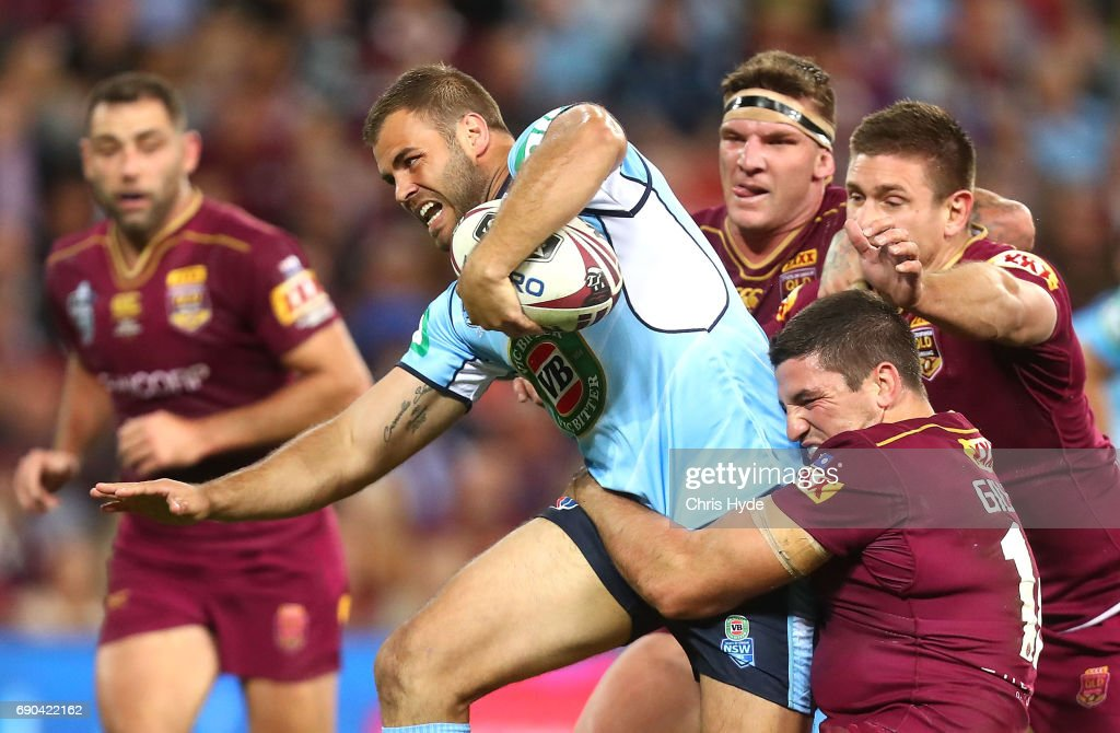 Wade Graham of the Blues is tackled by Matt Gillett and Josh McGuire of the Maroons during game one of the State Of Origin series between the Queensland Maroons and the New South Wales Blues at Suncorp Stadium on May 31, 2017 in Brisbane, Australia.