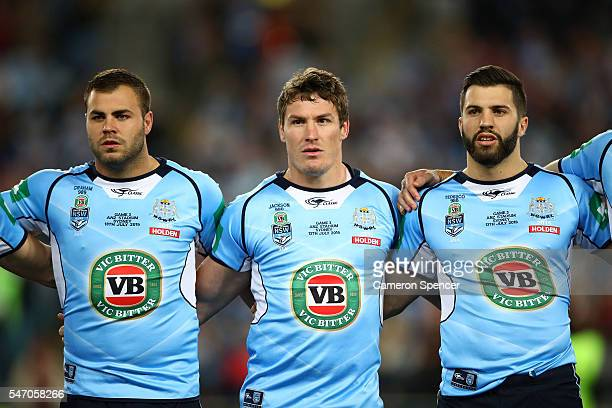 Wade Graham of the Blues Josh Jackson of the Blues and James Tedesco of the Blues sing the national anthem before game three of the State Of Origin...