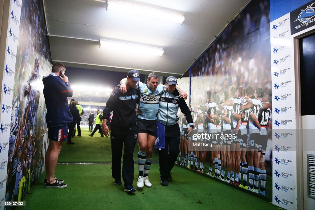 Wade Graham of the Sharks is assisted from the field after sustaining an injury during the round 25 NRL match between the Cronulla Sharks and the Sydney Roosters at Southern Cross Group Stadium on August 26, 2017 in Sydney, Australia.
