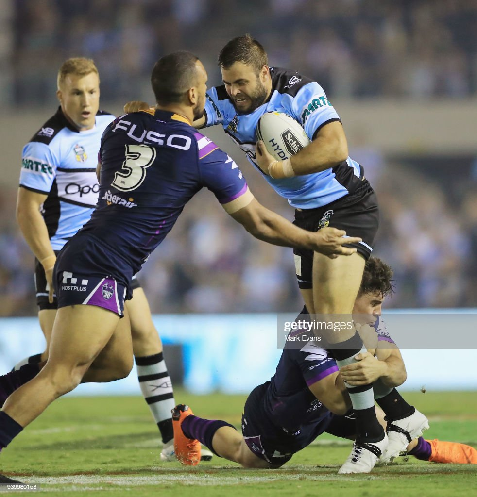 Wade Graham of the Sharks is tackled by Will Chambers of the Storm during the round four NRL match between the Cronulla Sharks and the Melbourne Storm at Southern Cross Group Stadium on March 30, 2018 in Sydney, Australia.