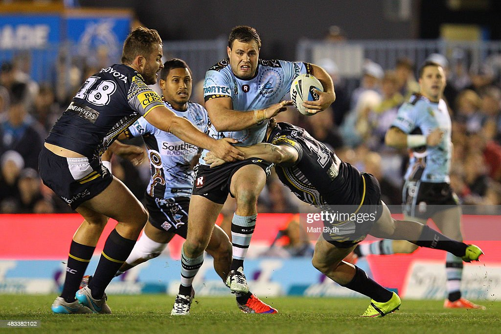 Wade Graham of the Sharks is tackled during the round 22 NRL match between the Cronulla Sharks and the North Queensland Cowboys at Remondis Stadium on August 8, 2015 in Sydney, Australia.