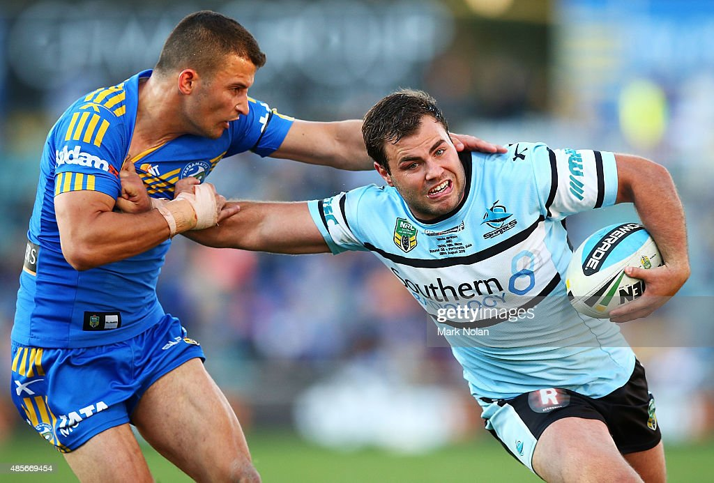Wade Graham of the Sharks is tackled during the round 25 NRL match between the Parramatta Eels and the Cronulla Sharks at Pirtek Stadium on August 29, 2015 in Sydney, Australia.