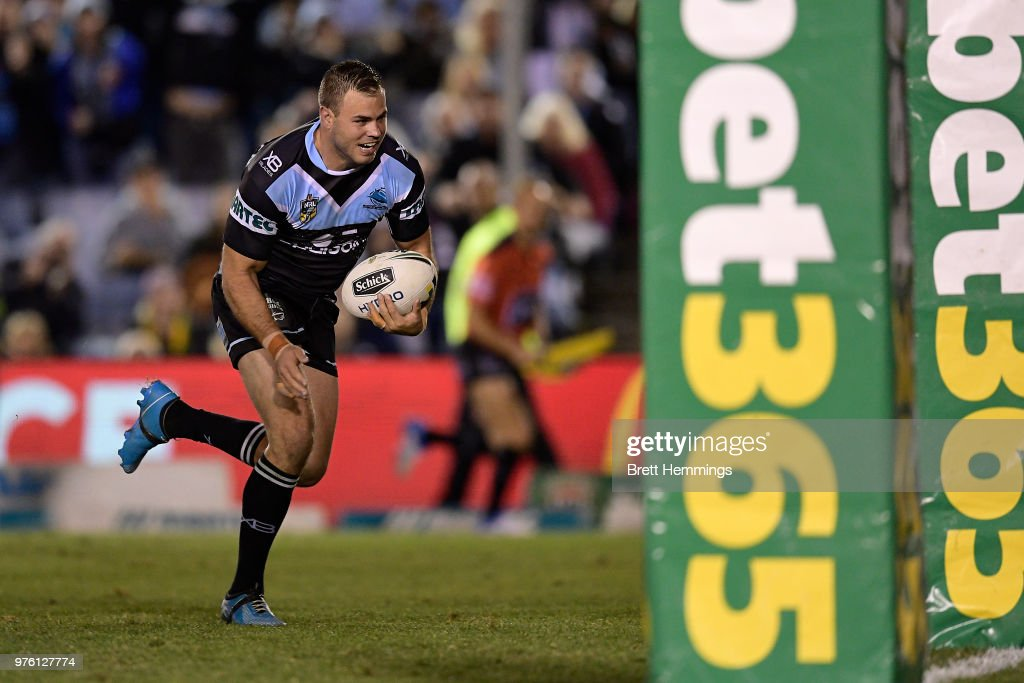 Wade Graham of the Sharks makes a break to score a try during the round 15 NRL match between the Cronulla Sharks and the Brisbane Broncos at Southern Cross Group Stadium on June 16, 2018 in Sydney, Australia.