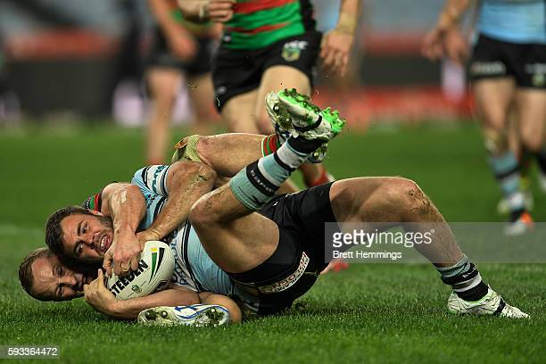 Wade Graham of the Sharks scores a try during the round 24 NRL match between the South Sydney Rabbitohs and the Cronulla Sharks at ANZ Stadium on...