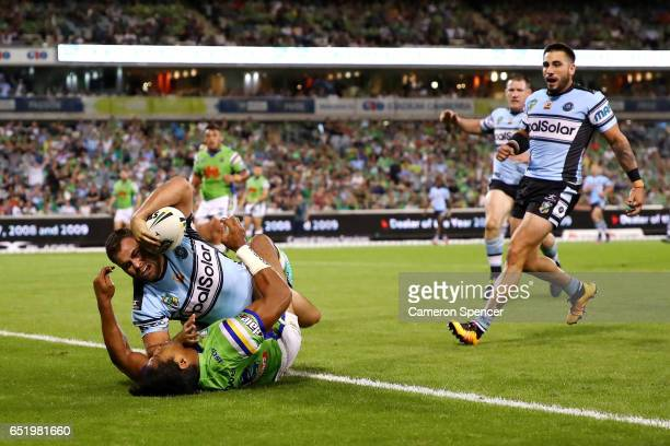 Wade Graham of the Sharks scores a try during the round two NRL match between the Canberra Raiders and the Cronulla Sharks at GIO Stadium on March 11...