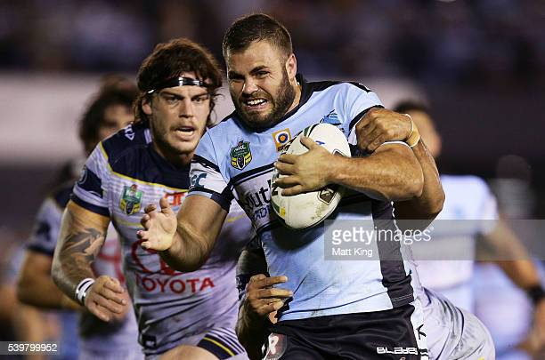 Wade Graham of the Sharks takes on the defence during the round 14 NRL match between the Cronulla Sharks and the North Queensland Cowboys at Southern...