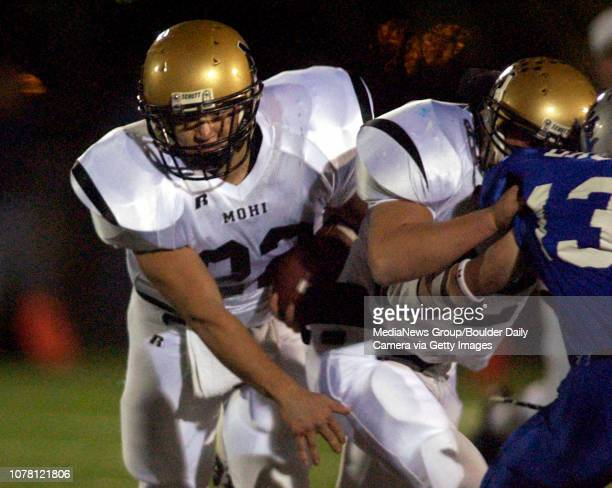 Wade Landowski left Monarch High School moves past a Broomfield High School player being blocked during the first half of play Friday at Elizabeth...