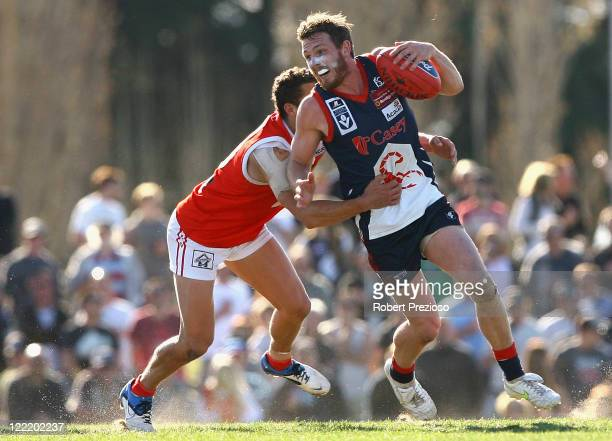 Wade Lees of the Scorpions is tackled during the round 22 VFL match between the Casey Scorpions and the Northern Bullants at Casey Fields on August...