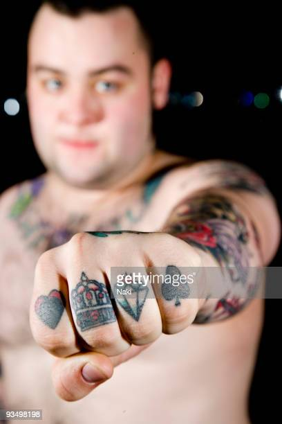 Wade McNeil of Alexisonfire poses backstage at the Astoria showing his tattoos on March 2nd 2007 in London