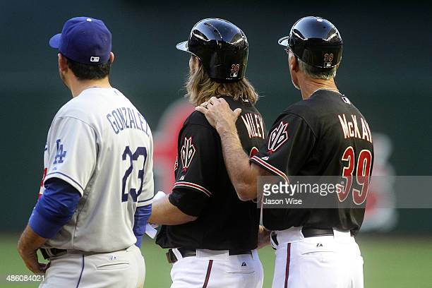 Wade Miley and Dave McKay of the Arizona Diamondbacks relax after a single with Adrian Gonzalez of Los Angeles Dodgers at Chase Field on April 12...